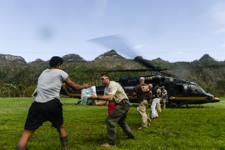 The U.S. Department of Homeland Security delivers food and water to isolated Puerto Rico residents after their bridge was destroyed by Hurricane Maria in the mountains around Utuado, Puerto Rico, Oct. 12, 2017. The Federal Emergency Management Agency and its federal partners continue 24-hour operations to conduct missions in support of those affected by Hurricane Maria.