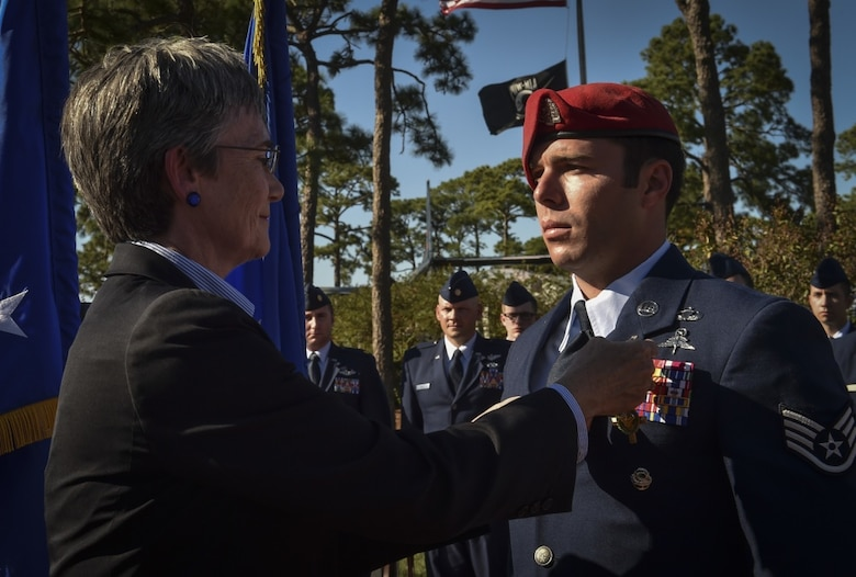 Secretary of the Air Force, Heather Wilson, pins the Air Force Cross on Staff Sgt. Richard Hunter, a Special Tactics Airman with the 23rd Special Tactics Squadron, during a combined medal ceremony Oct. 17, 2017, at Hurlburt Field, Fla. The SECAF awarded ten Air Force Special Operations Command Air Commandos valorous medals, including the Air Force Cross, for their combined efforts during a fierce firefight in a village near Kunduz Province, Afghanistan on Nov. 2, 2016. Hunter, a combat controller, was awarded the Air Force Cross and nine aircrew members on Spooky 43, an AC-130U Gunship with the 4th Special Operations Squadron, received Distinguished Flying Crosses and Air Medals with valor. Their actions on the ground, and in the air, were credited with saving more than 50 lives and eliminating 27 enemy forces.