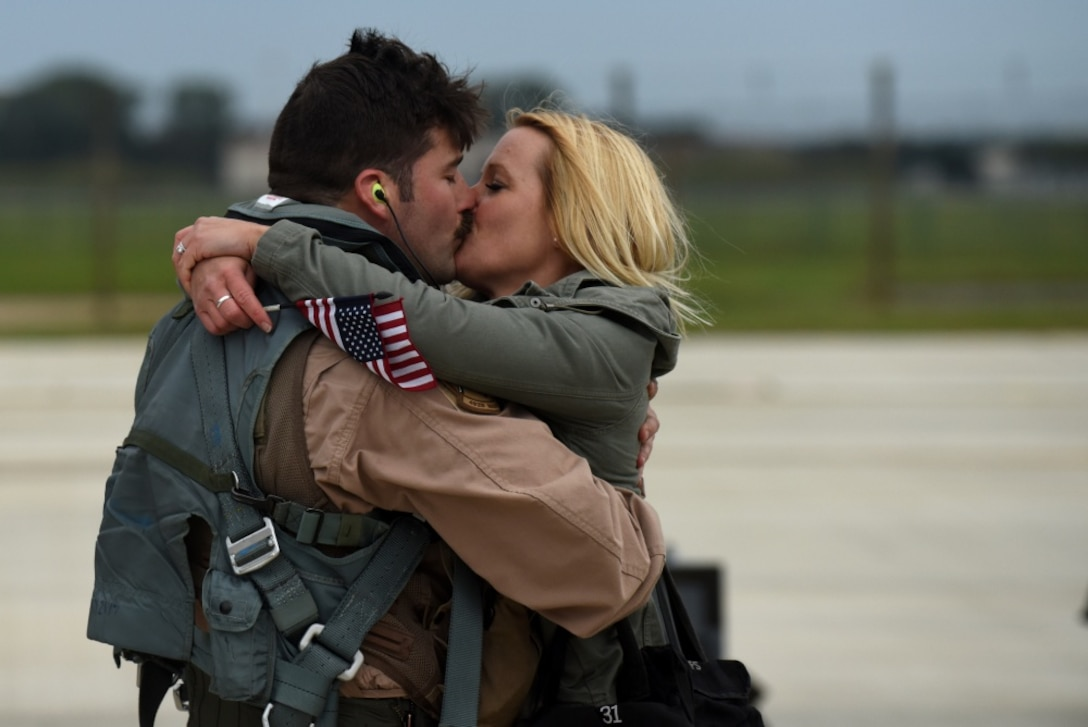 A 492nd Fighter Squadron member greets his wife after returning from a deployment, Oct. 4., 2017, at RAF Lakenheath, England. F-15E Strike Eagles and Airmen from the 492nd Fighter Squadron and supporting units across the 48th Fighter Wing returned from a six-month deployment to an undisclosed location in Southwest Asia.