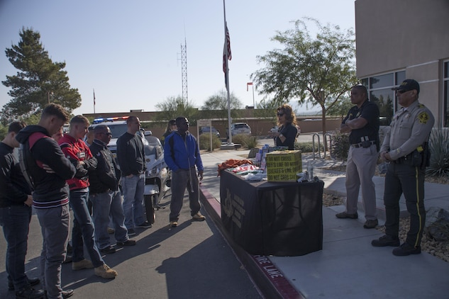 Employees with San Bernardino County Sherriff's Department brief motorcyclists on the procedures of a domestic violence case during the 4th Annual Roar Against Domestic Violence Motorcycle Ride, Oct. 13, 2017. The ride was hosted to raise awareness for domestic violence amongst Combat Center patrons as well as provide them with resources in the event that they suspect an incident of domestic violence has occurred. (U.S. Marine Corps photo by Cpl. Maliek Fowler)