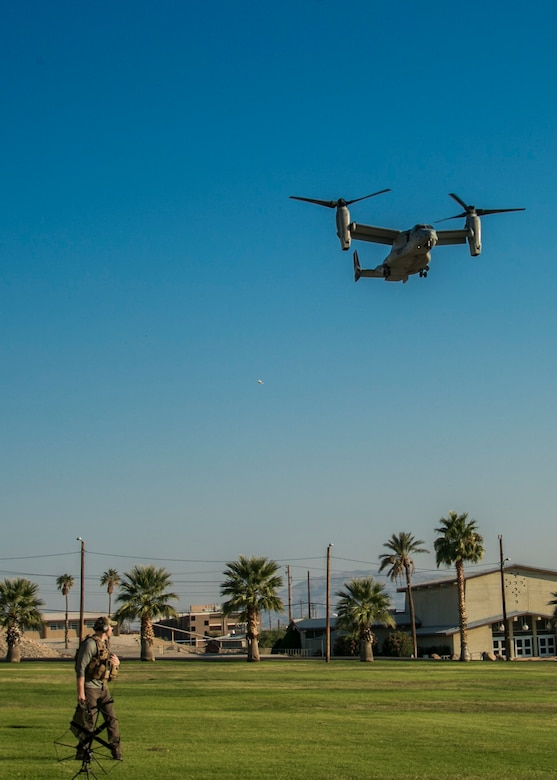Master Sgt. Matthew Dank, air traffic controller, Marine Aviation Weapons and Tactics Squadron One, watches as a MV-22 Osprey comes in to land on Lance Cpl. Torrey L. Gray Field aboard the Marine Corps Air Ground Combat Center, Twentynine Palms, Calif., Oct. 13, 2017. The landing was conducted as part of a non-combatant evacuation operation exercise in order to prepare Marines for the evacuation of non-essential U.S. citizens and Department of Defense personnel from dangerous situations overseas. (U.S. Marine Corps photo by Lance Cpl. Isaac Cantrell)