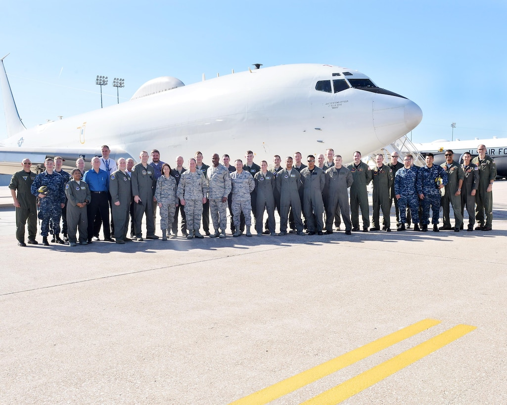 Chief of Staff of the Air Force Gen. David L. Goldfein, sixth from the left in the front row, and Chief Master Sgt. of the Air Force Kaleth O. Wright, fifth from the right in the front row, pose for a photo in front of a Boeing E-6B Mercury Navy aircraft with the 625th Strategic Operations Squadron at Offutt Air Force Base, Nebraska, Oct. 18, 2017. Goldfein and Wright spent much of the day touring the facilities and gaining insight into the base's 