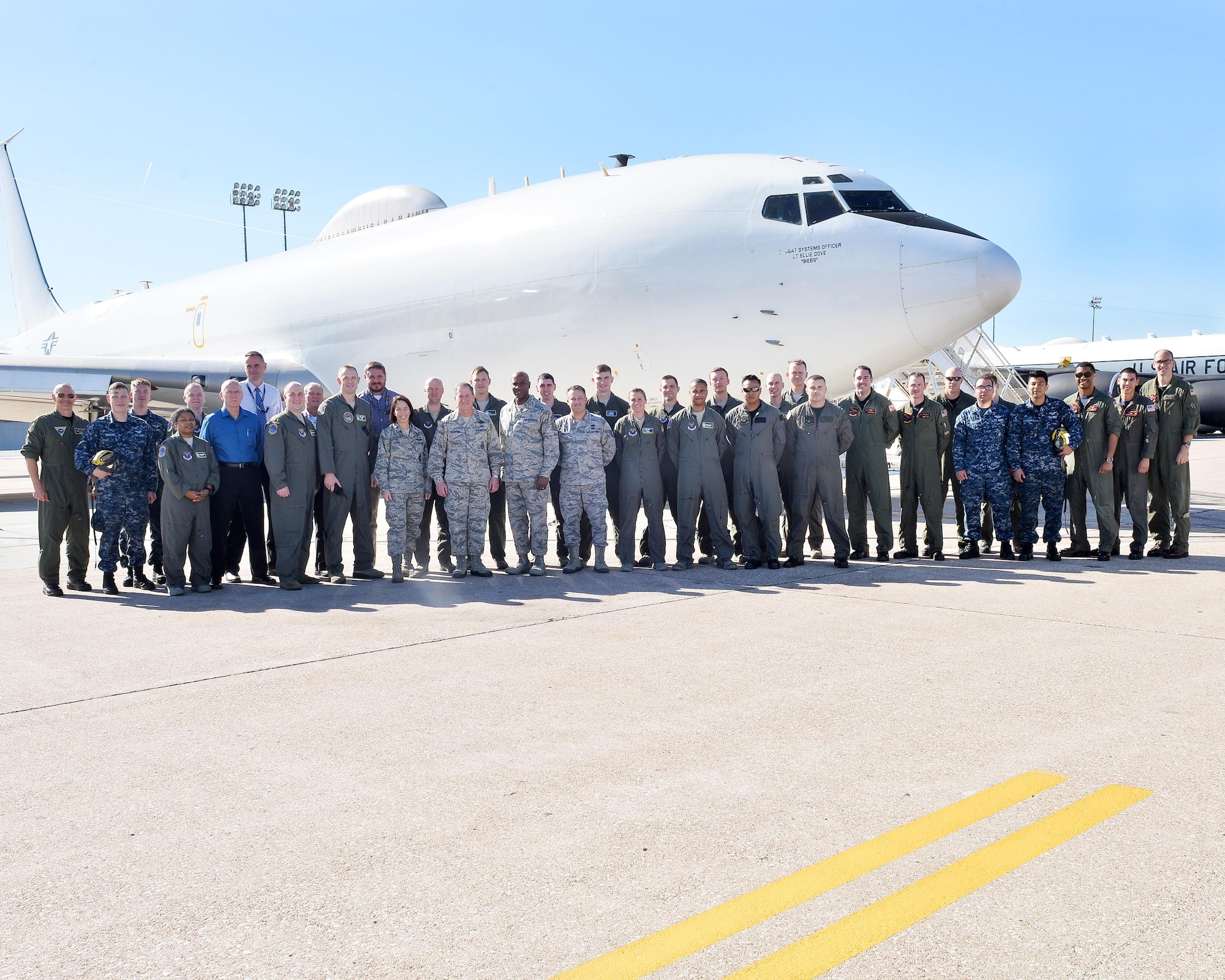 Chief of Staff of the Air Force Gen. David L. Goldfein, sixth from the left in the front row, and Chief Master Sgt. of the Air Force Kaleth O. Wright, fifth from the right in the front row, pose for a photo in front of a Boeing E-6B Mercury Navy aircraft with the 625th Strategic Operations Squadron at Offutt Air Force Base, Nebraska, Oct. 18, 2017. Goldfein and Wright spent much of the day touring the facilities and gaining insight into the base's  current mission sets.