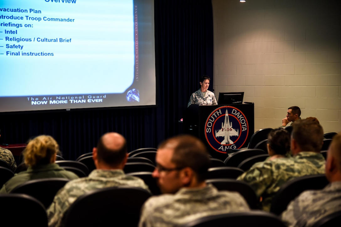 Senior Master Sgt. Becky Langloss, 114th Fighter Wing recruiting retention superintendent, briefed Airmen during the Phase 1 of the Attack Response Exercise (ARE) Oct. 10, 2017, Joe Foss Field, S.D.
