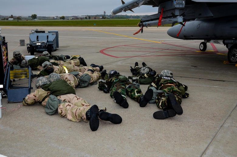 114th Aircraft Maintenance Airmen took cover while wearing their chemical protective gear during the Phase 2 of the Attack Response Exercise (ARE) Oct. 14, 2017, Joe Foss Field, S.D.