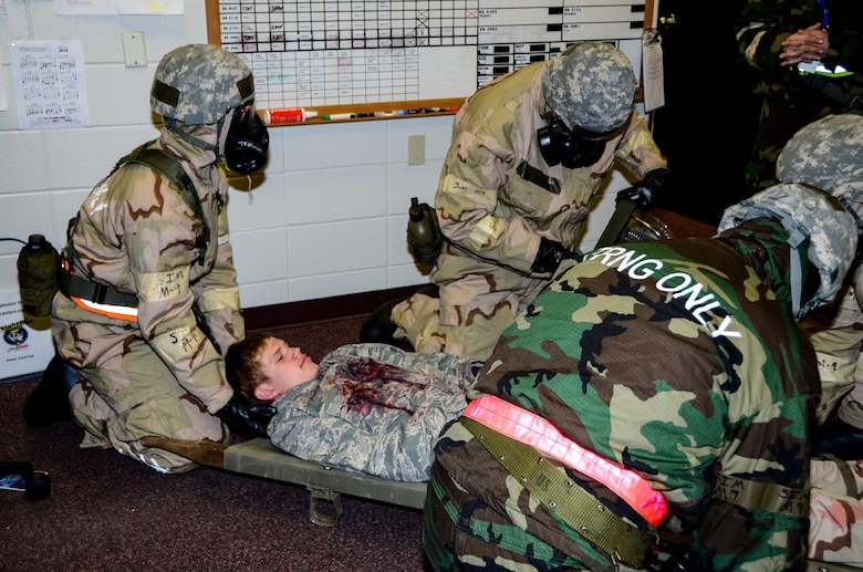 14th Maintenance Squadron Airmen tend to a simulated injured Airman during the Phase 2 of the Attack Response Exercise (ARE) Oct. 14, 2017, Joe Foss Field, S.D.