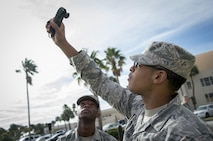 U.S. Air Force Airman 1st Class Keith Hickson Jr., a cable and antenna maintenance technician assigned to the 6th Communications Squadron, learns how to use a Kestrel weather meter during a Shadow Program at MacDill Air Force Base, Fla. Oct. 18, 2017. Each Shadow Day, there is one junior and senior enlisted member recommended from the participating squadron to visit another selected squadron. (U.S. Air Force photo by Senior Airman Mariette Adams)