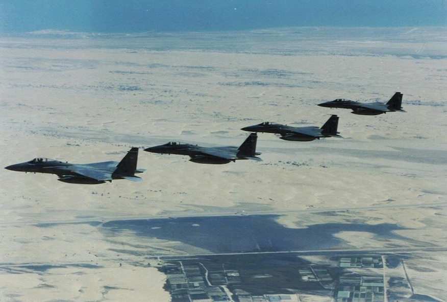 "In this historic photo, a four-ship of F-15 Eagles, deployed from Eglin, fly over the Persian Gulf. Throughout the 90s, then-named 33rd Tactical Fighter Wing flew combat air patrol and high value airborne asset protection missions as part of Operations DESERT STORM and SOUTHERN WATCH. Known for the most combat kills, the wing ""Nomads"" ended the operational missions with 16 aerial victories. Today, the wing continues its air dominance by training pilots and maintainers for the military's future generation as DoD's Integrated Training Center for the F-35. (Courtesy photo)"