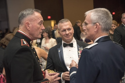 Marine Corps Gen. Joe Dunford, chairman of the Joint Chiefs of Staff; Army Command Sgt. Maj. John W. Troxell, senior enlisted advisor to the chairman of the Joint Chiefs of Staff; and Air Force Gen. Paul J. Selva, vice chairman of the Joint Chiefs of Staff; speak before the start of the 2017 USO Gala in Washington.