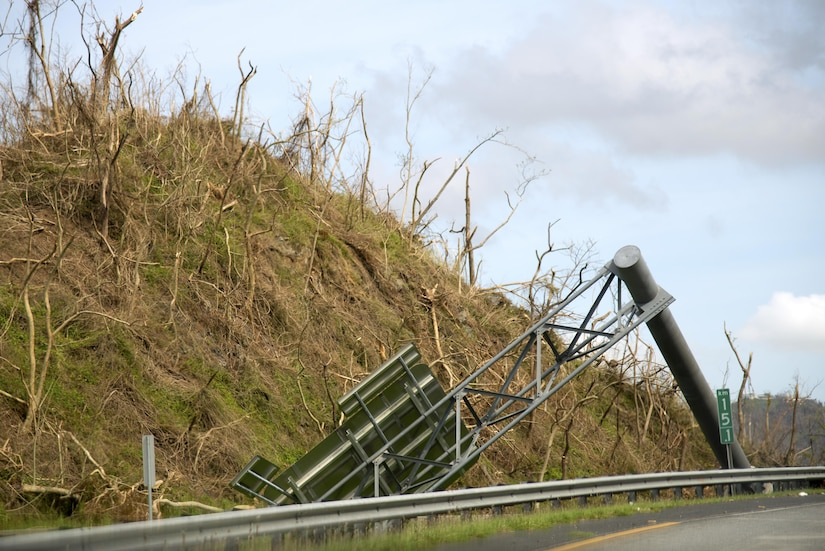 A fallen highway sign lays on the side of the road on Puerto Rico Highway 1, Oct. 1, 2017. Hurricane Maria damaged much of the island's infrastructure, making difficult to travel.