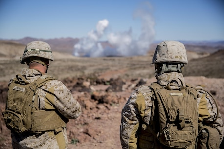 Chief Warrant Officer 4 Keith Marine and Master Gunnery Sgt. James Gominsky, oversee 3rd Battalion, 4th Marine Regiment's Marine Corps Combat Readiness Evaluation at Marine Corps Air Ground Combat Center Twentynine Palms, Calif., Mar. 2, 2017.