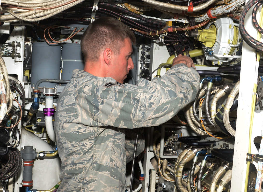Airman 1st Class Justin Bussell, an aerospace propulsion technician assigned to the 28th Aircraft Maintenance Squadron, repairs cables inside a B-1 Bomber at Ellsworth Air Force Base, S.D., Oct. 17, 2017. Bussell and the other maintainers had to ensure the aircraft leaving for Green Flag 18-1 were at their peak performance. (U.S. Air Force photo by Airman 1st Class Thomas Karol)