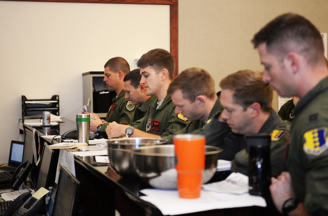 Capt. Ryan Kerns, an instructor pilot assigned to the 34th Bomb Squadron, gives a mission brief before aircrew members depart from Ellsworth Air Force Base, S.D., for the Green Flag exercise 18-1 on Oct. 18, 2017. Aircrew members will be flying in air-to-ground missions for U.S. Army units on the ground. Green Flag exercises focuses on close-air support training which is different from Red Flag exercises which focus on air-to-air combat missions. (U.S. Air Force photo by Airman 1st Class Thomas Karol)