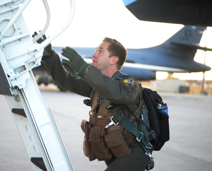 Capt. Ryan Koelling, a weapons system officer assigned to the 34th Bomb Squadron, boards a B-1 Bomber at Ellsworth Air Force Base, S.D., Oct. 18, 2017. Approximately 200 Ellsworth Airmen departed for Nellis AFB, to train with Joint Terminal Attack Controllers and soldiers from U.S. Army National Training Center in Fort Irwin, Calif., as part of Green Flag exercise 18-1. (U.S. Air Force photo by Airman 1st Class Thomas Karol)