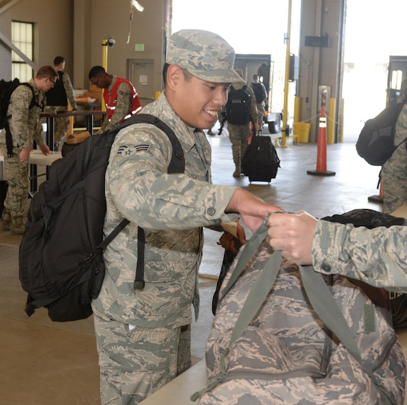 Senior Airman Peter J. Mandadero, a fuels facility operator assigned to the 28th Logistics Readiness Squadron, completes his bag check in the deployment center at Ellsworth Air Force Base, S.D., Oct. 16, 2017. More than 200 Airmen deployed to Nellis Air Force Base, Nev. to take part in Green Flag 18-1, a joint training exercise focused on air-to-ground and close-air support missions. (U.S. Air Force photo by Airman 1st Class Thomas Karol)