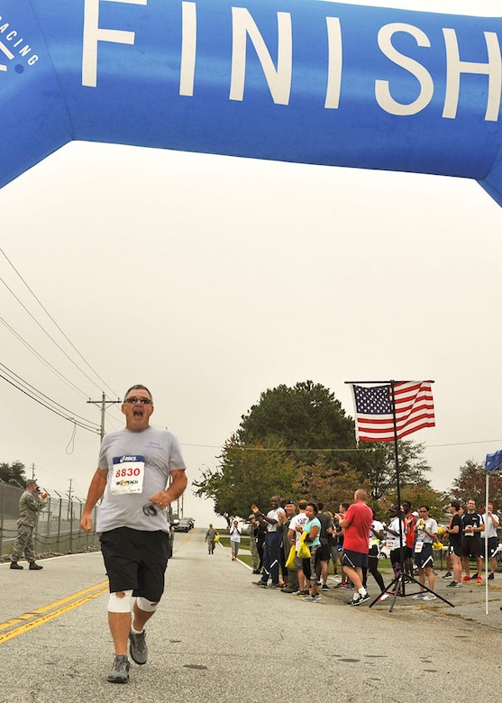 Master Sgt. (Ret.) Samuel Farmer of the 94th Civil Engineering Squadron, crosses the finish line of the 2017 Falcon 5K Run Oct. 15, 2017. After recently rocovering from open-heart surgery, Farmer wanted to complete the run, and support Airmen in need. (U.S. Air Force photo/Master Sgt. James Branch)