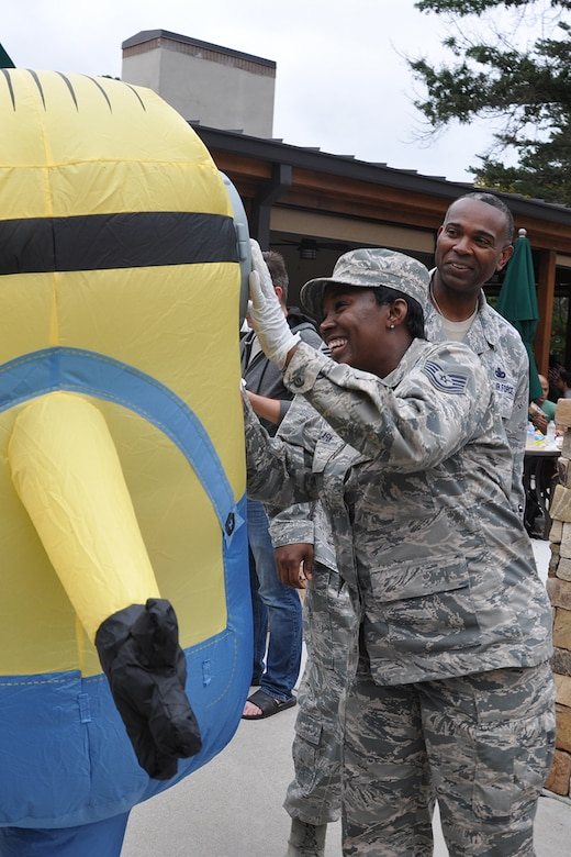 A Reserve Citizen Airman interacts with a mascot at this year's Family Day Oct. 14, 2017 at Dobbins Air Reserve Base, Ga. Family Day is held here annually as a way of bringing families on base to see what their Reserve Citizen Airmen do on drill weekends. (U.S. Air Force photo/Master Sgt. James Branch)