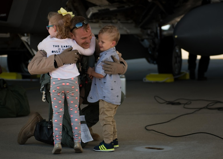 U.S. Air Force Lt. Col. Christian Bergtholdt, 27th Fighter Squadron director of operations, embraces his children upon returning to Joint Base Langley-Eustis, Va., Oct. 19, 2017.