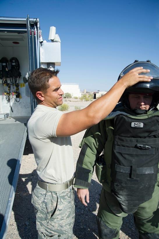 Senior Airman Jon Brauch adjusts a blast suit during an EOD exercise.