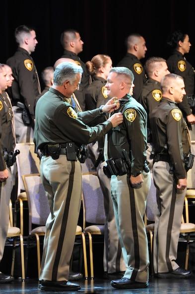 Senior Airman Brett Clashman graduated from the Las Vegas Metropolitan Police Academy June 14, 2016. Clashman is a photojournalist in the Air Force Reserve.