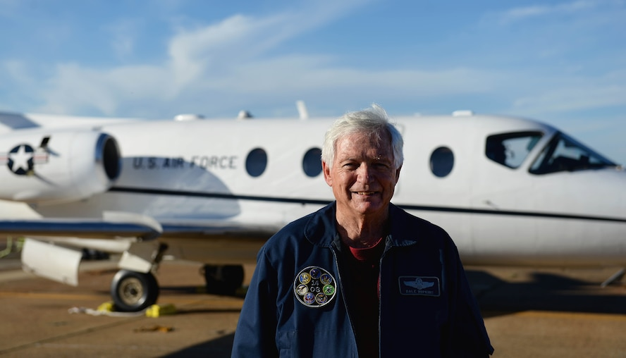 Dale Hopkins, T-1A Jayhawk simulation instructor pilot, stands in front of a T-1A Oct. 17, 2017, on Columbus Air Force Base, Mississippi. Since he retired as a colonel in 1989, he has continued his service to the Air Force as a sim instructor, his passion for aviation helping him teach the newest Air Force pilots. (U.S. Air Force photo by Airman 1st Class Keith Holcomb)