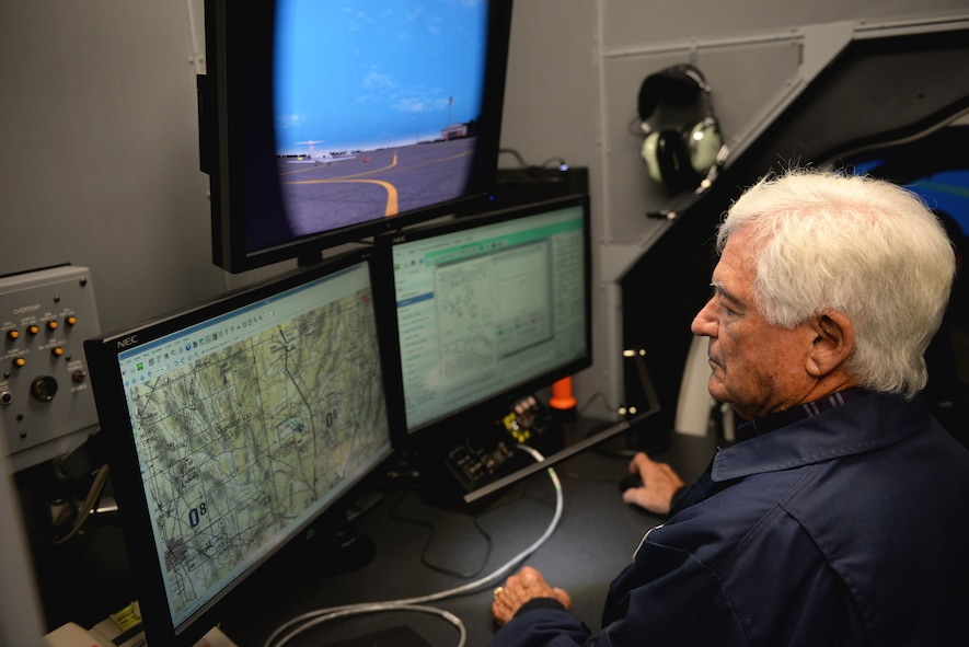Dale Hopkins, T-1A Jayhawk simulation instructor pilot, sets up a T-1 simulation Oct. 17, 2017, on Columbus Air Force Base, Mississippi. He briefs students before and after the three hours of flying in the simulation. He also helps students understand the T-1 and gives them feedback on their flight performance. (U.S. Air Force photo by Airman 1st Class Keith Holcomb)