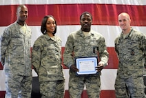 Airman 1st Class Mufasa Coley, a 14th Civil Engineer Squadron firefighter, is awarded the September BLAZE 5/6 Highlight Oct. 2, 2017, on Columbus Air Force Base, Mississippi, from members of the BLAZE 5/6.  Coley received the Blaze 5/6 Leadership Highlight Award for the month of September 2017 in recognition of his outstanding leadership.  Coley demonstrated superb firefighting during a house fire on base where he was a part of the initial attack team. He entered the house while it was ablaze and gathered critical infrastructure details of the fire spread and saved two family pets. His direct involvement contributed to the salvage of the building's contents and the safety of all seven residents involved.   Coley is also an avid football fan who is playing for his squadron flag football team and enjoys watching both college and professional games. He also has a passion for the medical treatment side of firefighting, and volunteers at local sporting events as a standby medic.