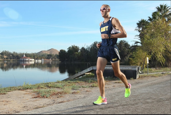 Lt. Patrick Hearn, assigned to Naval Surface Warfare Center (NSWC), Corona Division, runs around Lake Norconian.
