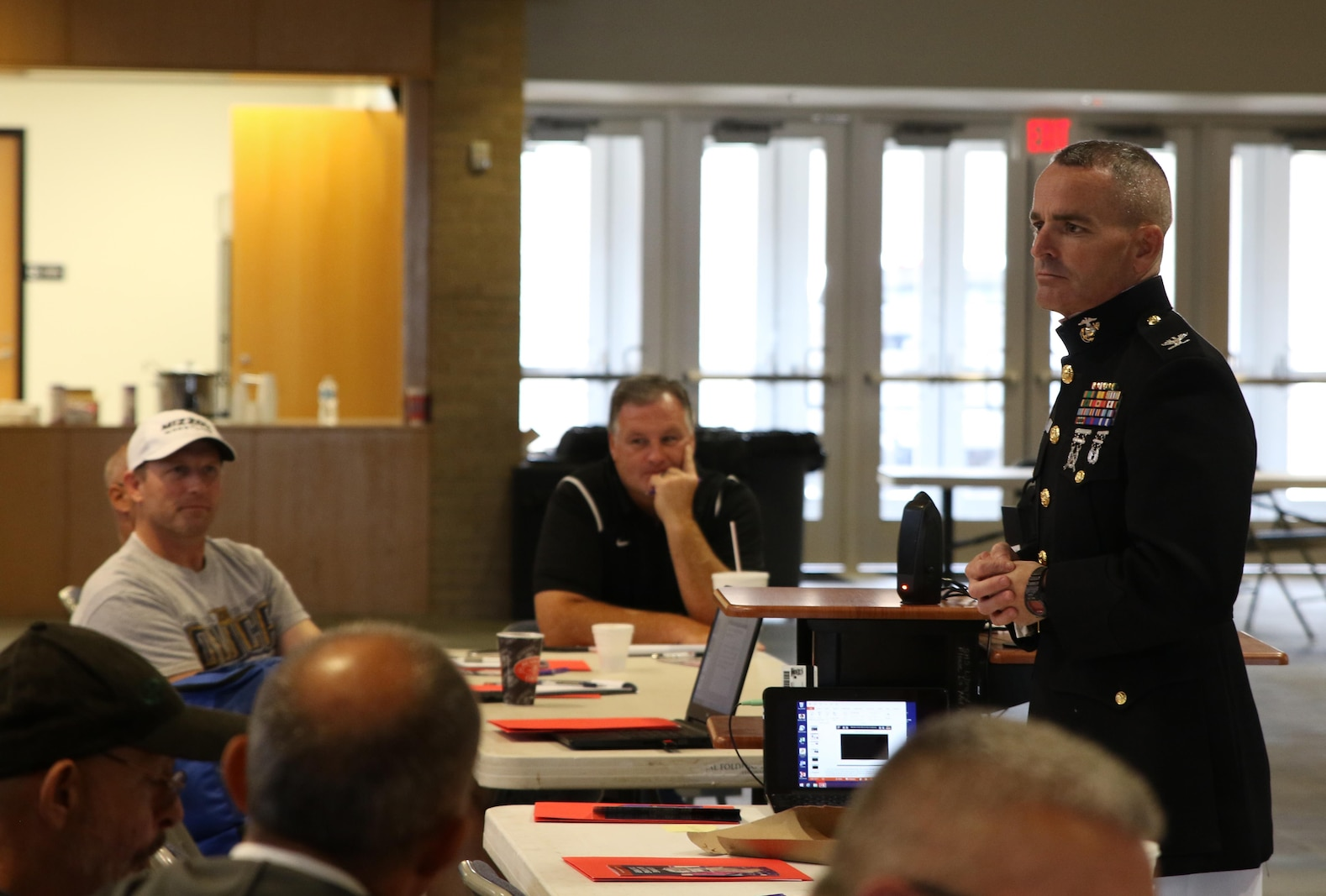 Colonel David Fallon, the 9th Marine Corps District commanding officer, speaks with wrestling coaches during the National Wrestling Coaches Association's Leadership Academy at Shawnee High School, Oct. 19. Fallon spoke to coaches about traits Marines and wrestlers share that make them stand out in society. (Official U.S. Marine photo by Sgt. Marcela Diazdeleon)