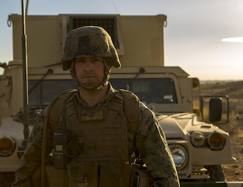 Sgt. Michael Kirby, a radio chief with 3rd Platoon, Rocket Battery F, 2nd Battalion, 14th Marine Regiment, 4th Marine Division, Marine Forces Reserve, poses for a photo in front of a Humvee during Weapons and Tactics Instructor course 1-18 at Chocolate Mountain Aerial Gunnery Range, Calif., Oct. 12, 2017.