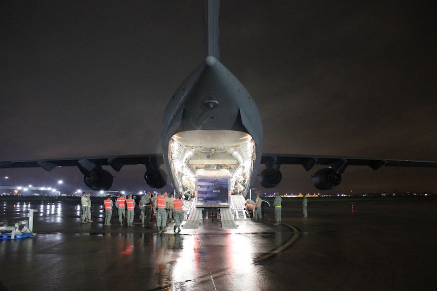 Airmen from the 123rd Airlift Wing load a Disaster Relief Mobile Kitchen Trailer onto a C-17 Globemaster III aircraft at the Kentucky Air National Guard Base in Louisville, Ky., Oct. 11, 2017, to be transported to San Juan, Puerto Rico. Seven Airmen from the wing's 123rd Services Flight will employ the trailer to serve up to 4,000 hot meals per day to hurricane relief forces. (U.S. Air National Guard photo by Lt. Col. Katrina Bramlett)