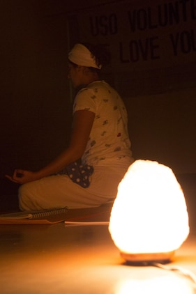 CAMP FOSTER, OKINAWA, Japan – A practitioner meditates in the light of a salt rock light USO Kundalini Yoga class Oct. 17 aboard Camp Foster, Okinawa, Japan.