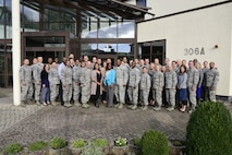 U.S. Air Forces in Europe superintendents and their spouses pose for a group photo during the USAFE Squadron Superintendents and Spouses course at Ramstein Air Base, Germany, Oct. 3, 2017.