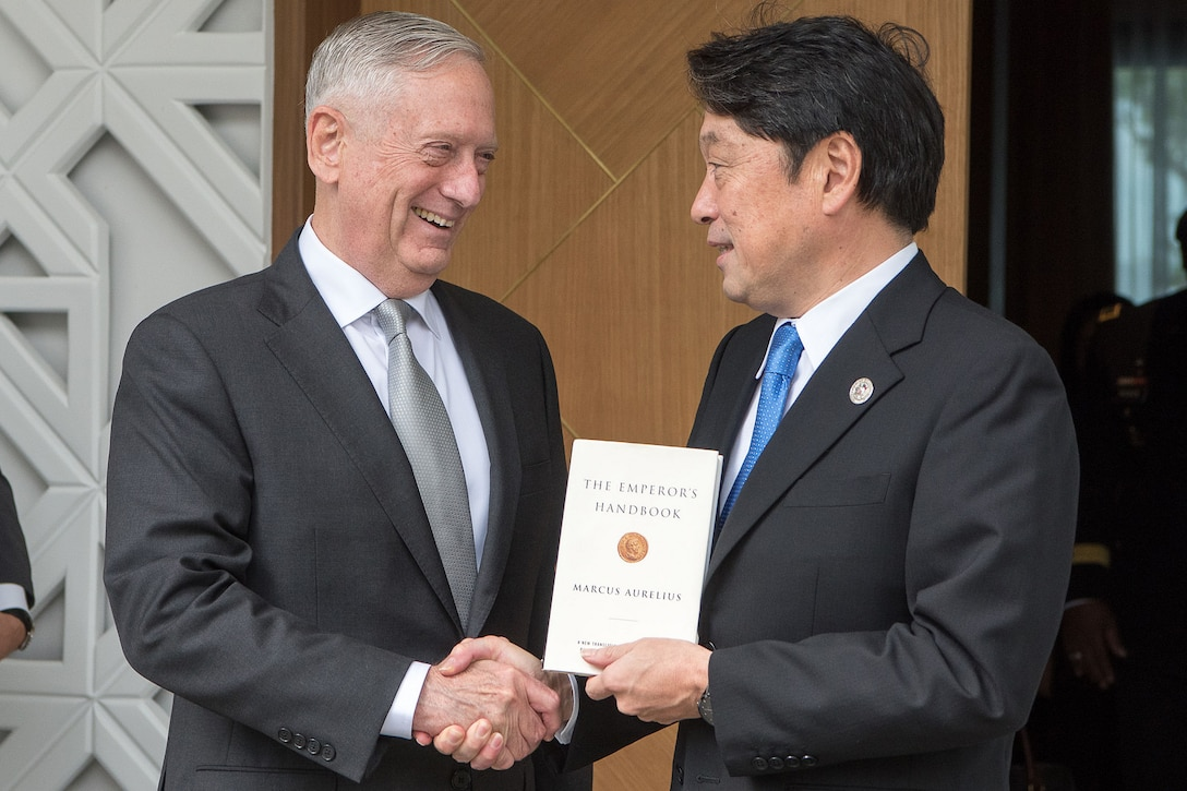 U.S. and Japanese defense leaders shake hands in the Philippines.