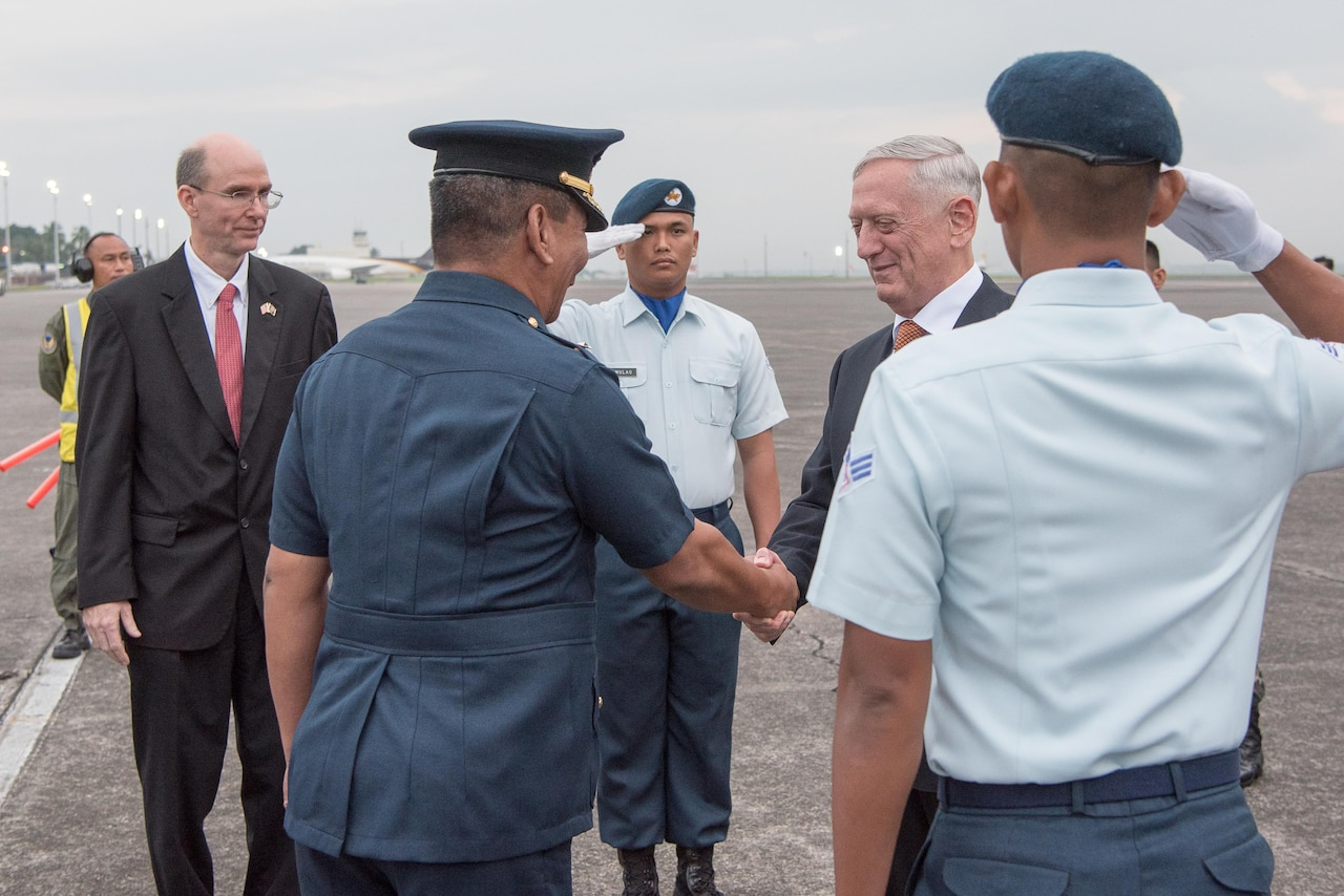 Defense Secretary Jim Mattis is greeted by Philippine defense officials after arriving in Clark, Philippines.