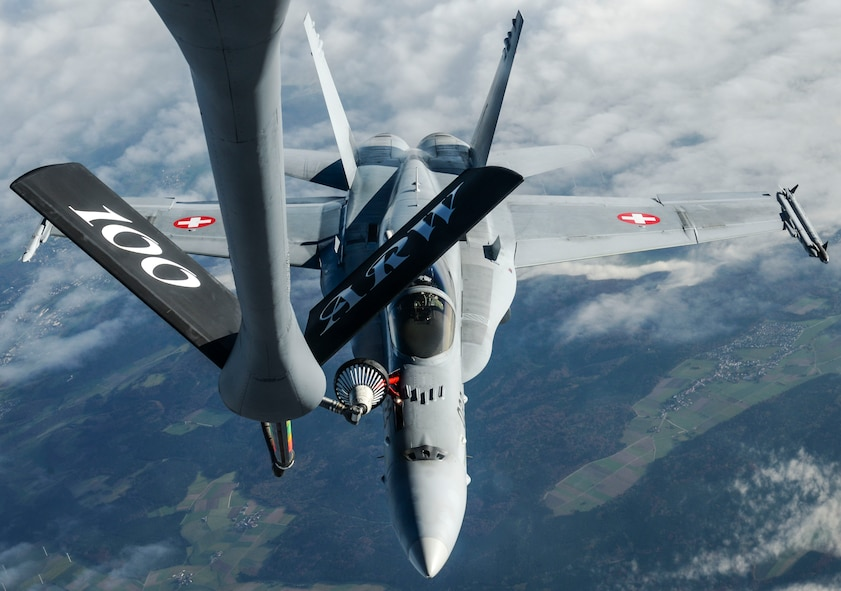 A U.S. Air Force KC-135 Stratotanker, assigned to the 100th Air Refueling Wing RAF Mildenhall, England, refuels a Swiss air force F-18 Hornet over Germany Oct 20, 2017. The 100th ARW theatre of operations covers Europe and Africa, supporting NATO and other nation missions.  (U.S. Air Force photo by Senior Airman Justine Rho)