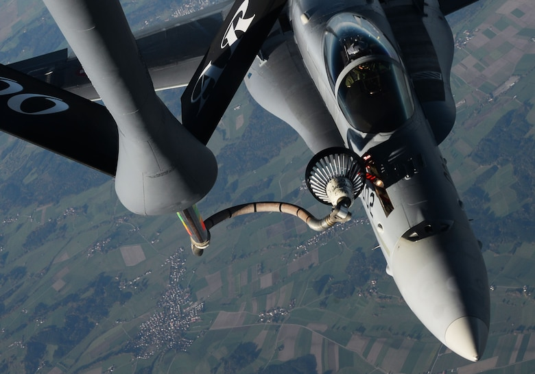 A U.S. Air Force KC-135 Stratotanker, assigned to the 100th Air Refueling Wing RAF Mildenhall, England, refuels a Swiss air force F-18 Hornet utilizing the hose and drogue system Oct. 20, 2017.  During aerial refueling, the drogue basket stabilizes the hose and acts as a funnel to aid insertion of the receiver aircraft's probe. (U.S. Air Force photo by Senior Airman Justine Rho)