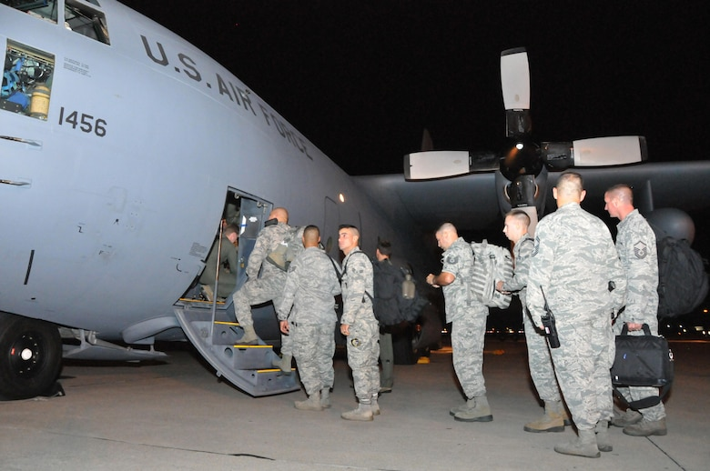 181st Security Forces Squadron load a C-130 Hercules aircraft at Hulman Field Air National Guard base, Oct. 9, 2017.