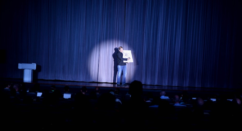 Jason Michaels, illusionist and magician, performs at the Kaye Auditorium Oct. 13, 2017, on Columbus Air Force Base, Mississippi. Michaels was diagnosed with Tourette's syndrome at 6 years old; overcoming it, he is now an international award-winning sleight-of-hand artist and professional speaker. (U.S. Air Force photo by Airman 1st Class Keith Holcomb)