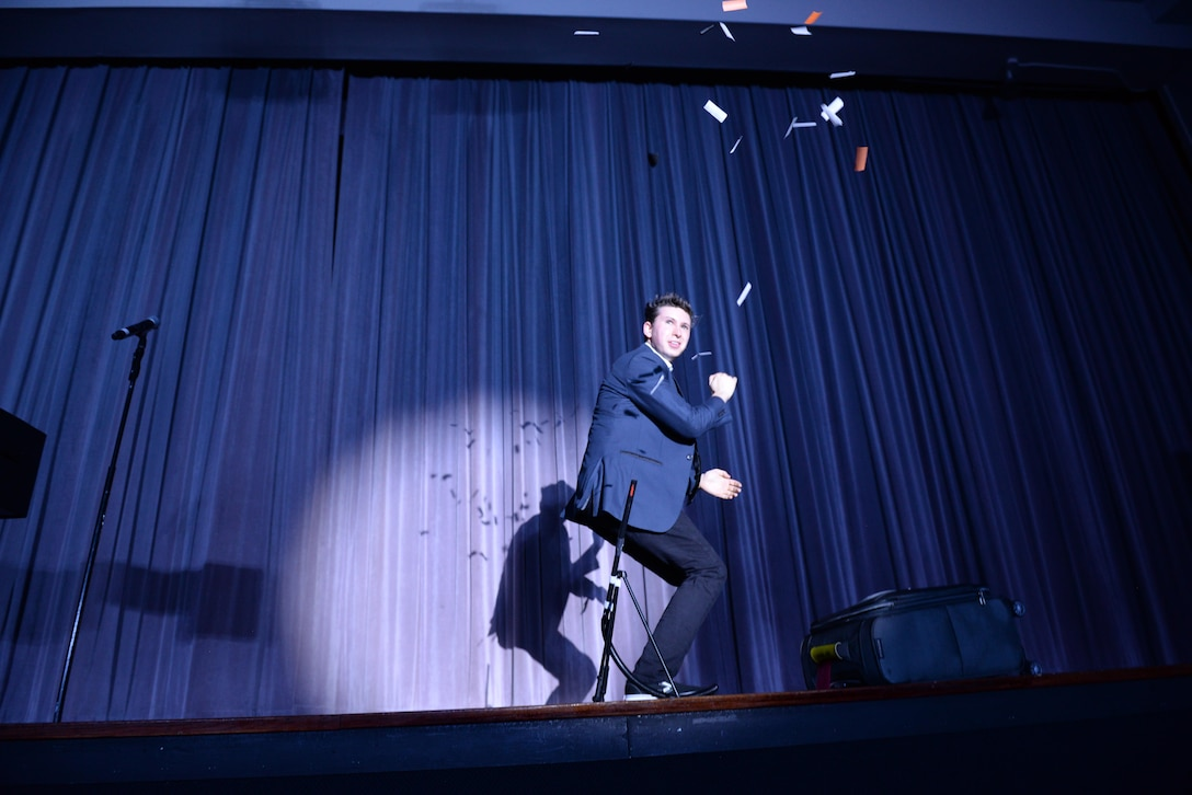 Benjamin Young, magician, performs during a show Oct. 13, 2017, on Columbus Air Force Base, Mississippi. Young is an opening magician and assistant for Jason Michaels, illusionist and magician, and they've been performing on military bases around the world. (U.S. Air Force photo by Airman 1st Class Keith Holcomb)