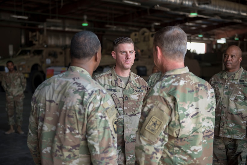Three soldiers standing together in a group.