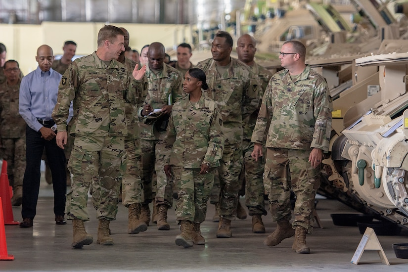 Group of Soliders walking through a warehouse