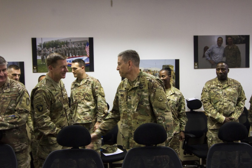 Two Army leaders shake hands.
