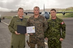 U.S. Marine Corps Cpl. Michael A. Fleenor, a heavy equipment operator with Joint Task Force Leeward Islands, poses for a photo with Royal Canadian Air Force Lt. Col. Paul-Éric Gilbert, left, the Royal Canadian Air Task Force commander, and Royal Canadian Air Force Master Warrant Officer Joel Langley, the ATF chief, after an award ceremony at Charles-Douglas Airport in Melville Hall, Dominica, Oct. 2, 2017. Fleenor was presented with a certificate of appreciation for his efforts in supporting both U.S. and foreign military efforts during hurricane relief operations in Dominica. Royal Canadian Air Force photo by Cpl. Gary Calvé