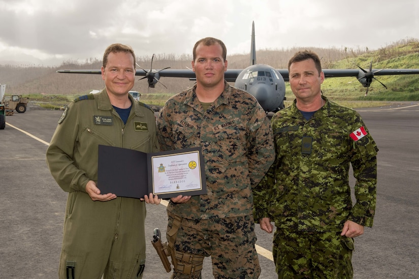 Marine receives award from Royal Canadian Air Force officials.