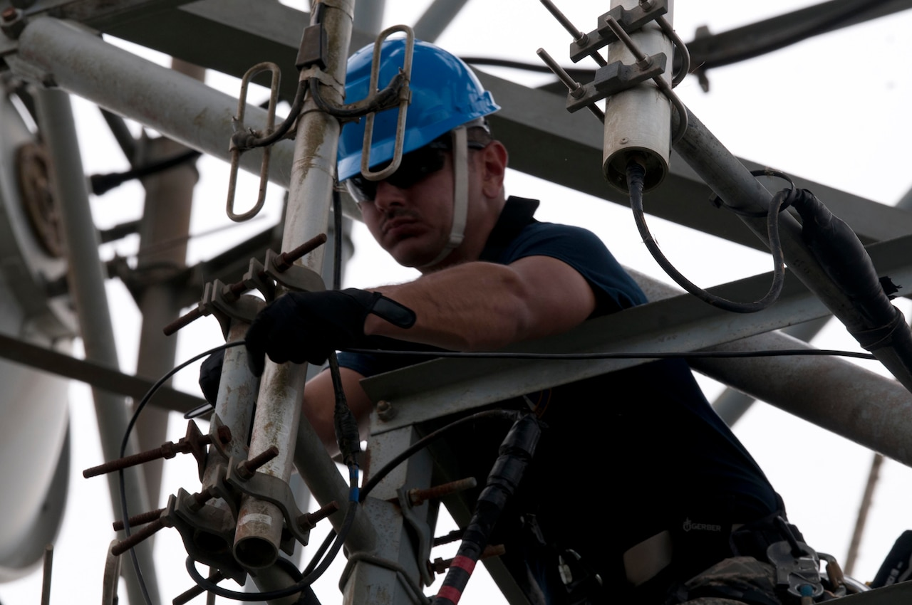 Air Force Capt. Jose Gutierrez del Arroyo, the deputy flight commander and a specialized engineer with the 85th Engineering and Installation Squadron, works on a damaged antenna at Cerra de Punta Mountain near Ponce, Puerto Rico, Oct. 20, 2017. The 85th EIS are working to reestablish and improve radio communications for local emergency personnel and first responders across the island. Army photo by Sgt. Thomas Calvert