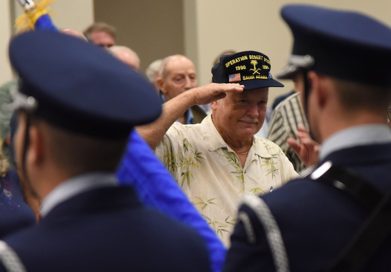U.S. Army retired Sgt. 1st Class Tom Carpenter renders a salute during the singing of the national anthem during Retiree Appreciation Day at the Roberts Consolidated Aircraft Maintenance Facility Oct. 20, 2017, on Keesler Air Force Base, Mississippi. The annual event, sponsored by the Keesler Retiree Activities Office, included more than 20 displays with information pertinent to retirees and a free lunch. (U.S. Air Force photo by Kemberly Groue)