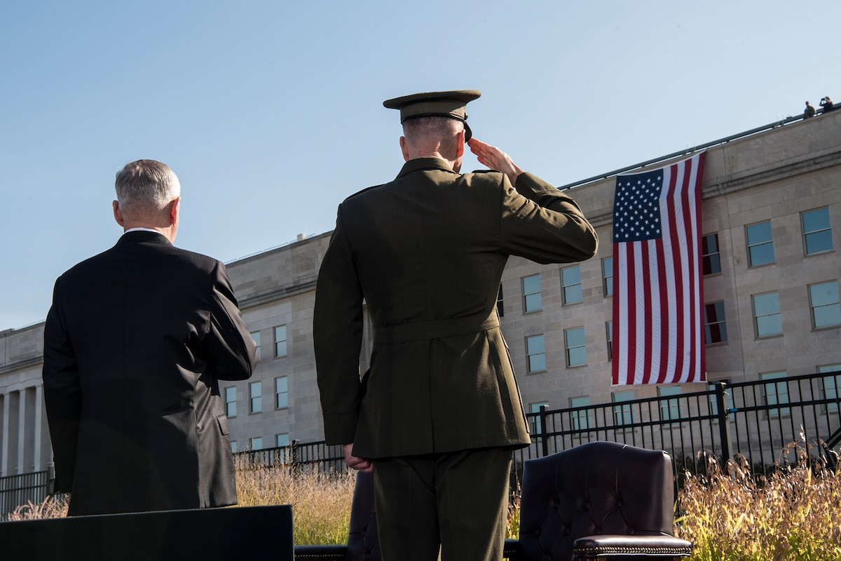 Defense Secretary James N. Mattis and Marine Corps Gen. Joe Dunford salute the flag.