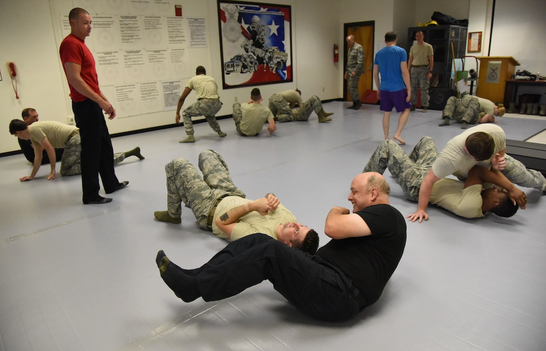 Members of the 81st Security Forces Squadron practice combative techniques during an 81st SFS combative training course at the SFS building Oct. 19, 2017, on Keesler Air Force Base, Mississippi. Approximately 15-20 defenders were taught skills vital to surviving a hand-to-hand ground fight using mixed martial arts and Jiu Jitsu techniques as another tool to survive a confrontational environment. (U.S. Air Force photo by Kemberly Groue)