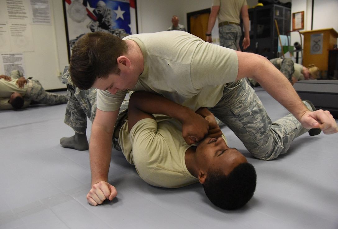 Senior Airman Jordan Johnson, 81st Security Forces Squadron patrolman, and Staff Sgt. Forrest Washington, 81st SFS patrolman, practice a combative technique during an 81st SFS combative training course at the SFS building Oct. 19, 2017, on Keesler Air Force Base, Mississippi. Approximately 15-20 defenders were taught skills vital to surviving a hand-to-hand ground fight using mixed martial arts and Jiu Jitsu techniques as another tool to survive a confrontational environment. (U.S. Air Force photo by Kemberly Groue)